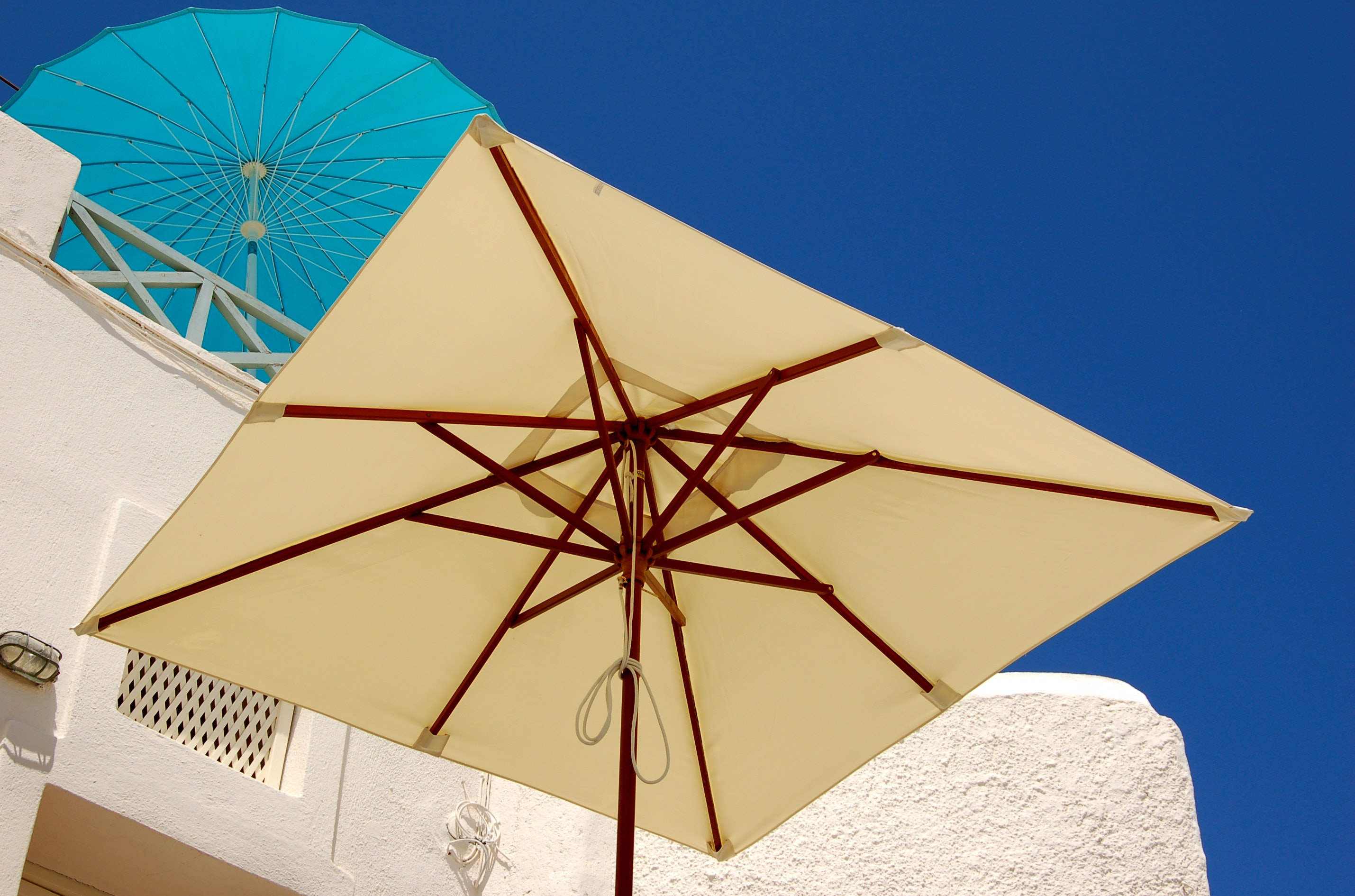 yellow and brown patio umbrella
