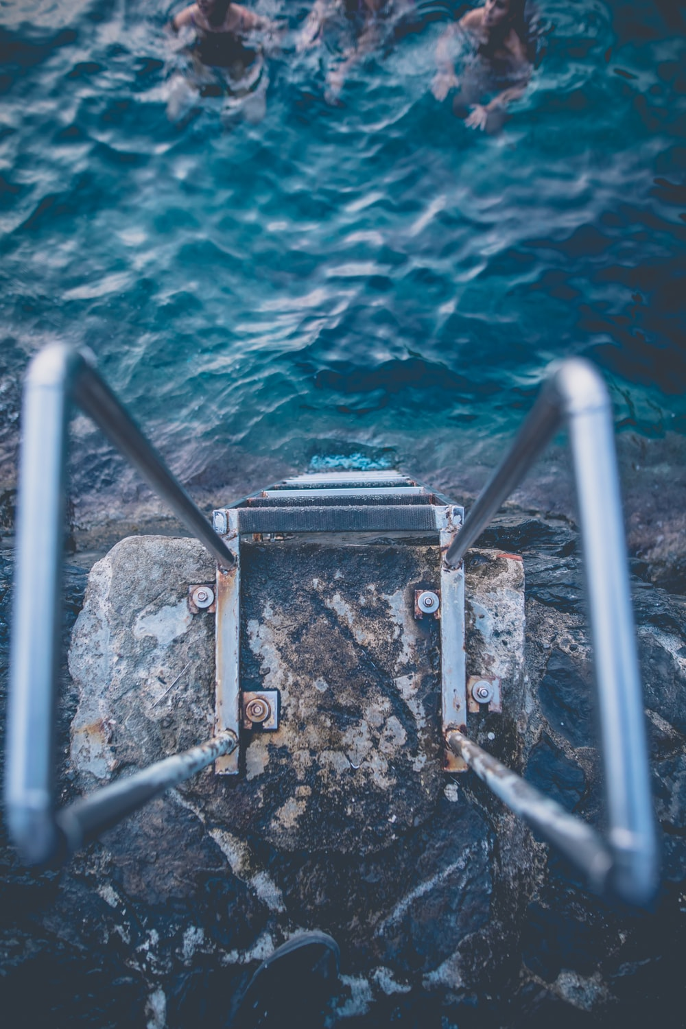point of view photography of gray metal ladder