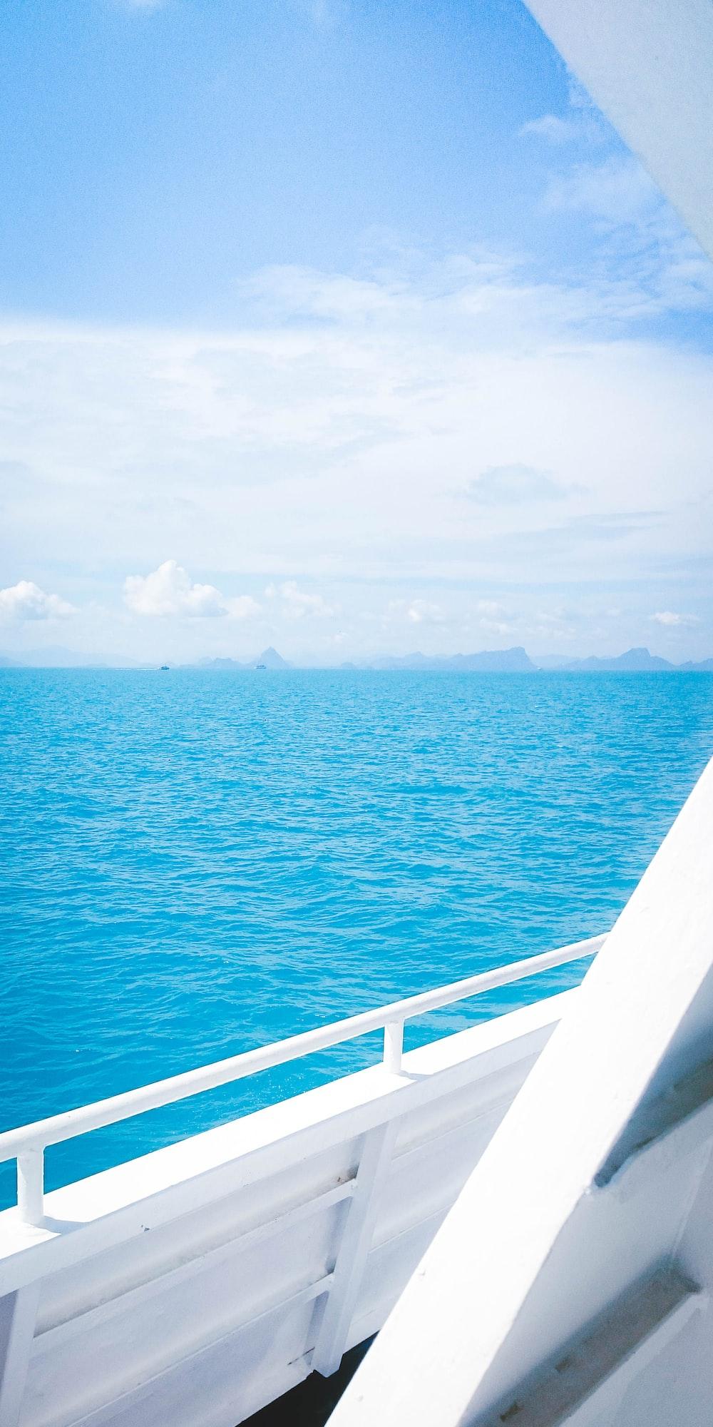 white boat voyaging on ocean during daytime