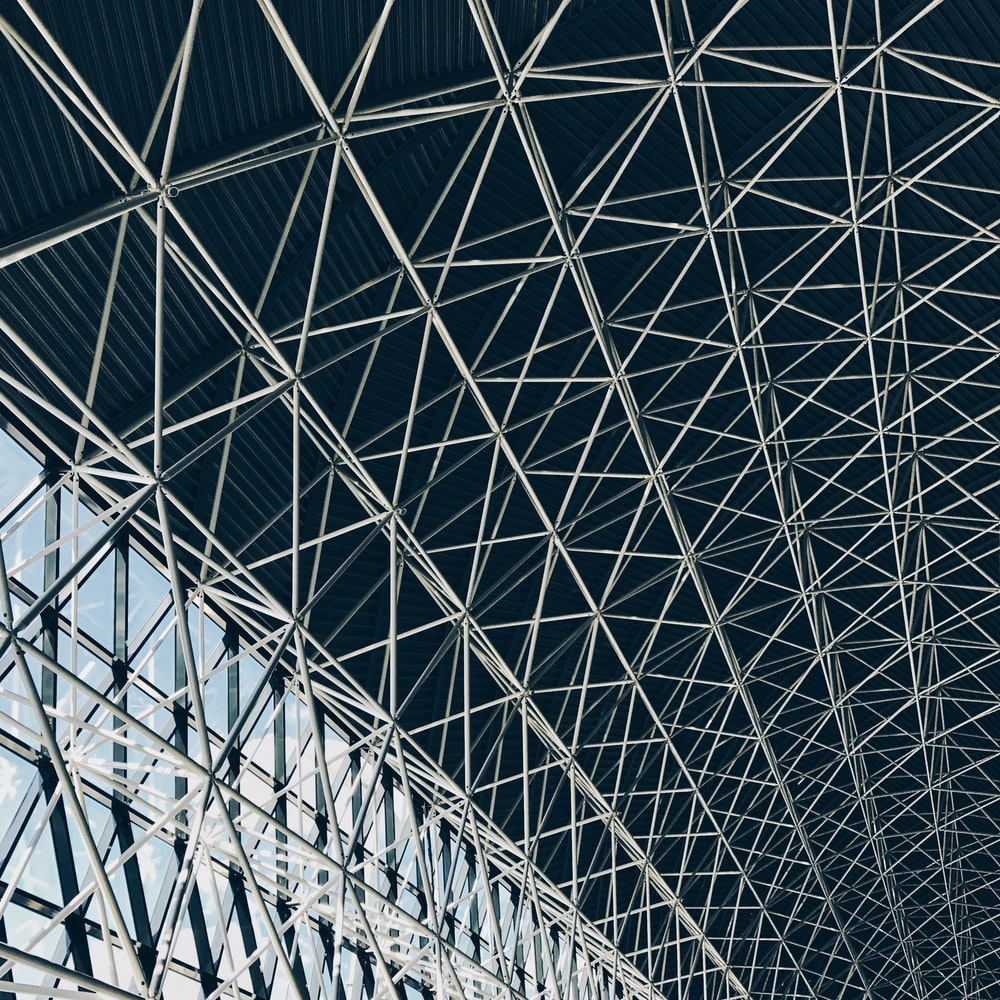 worm's-eye view of steel frame of indoor structure