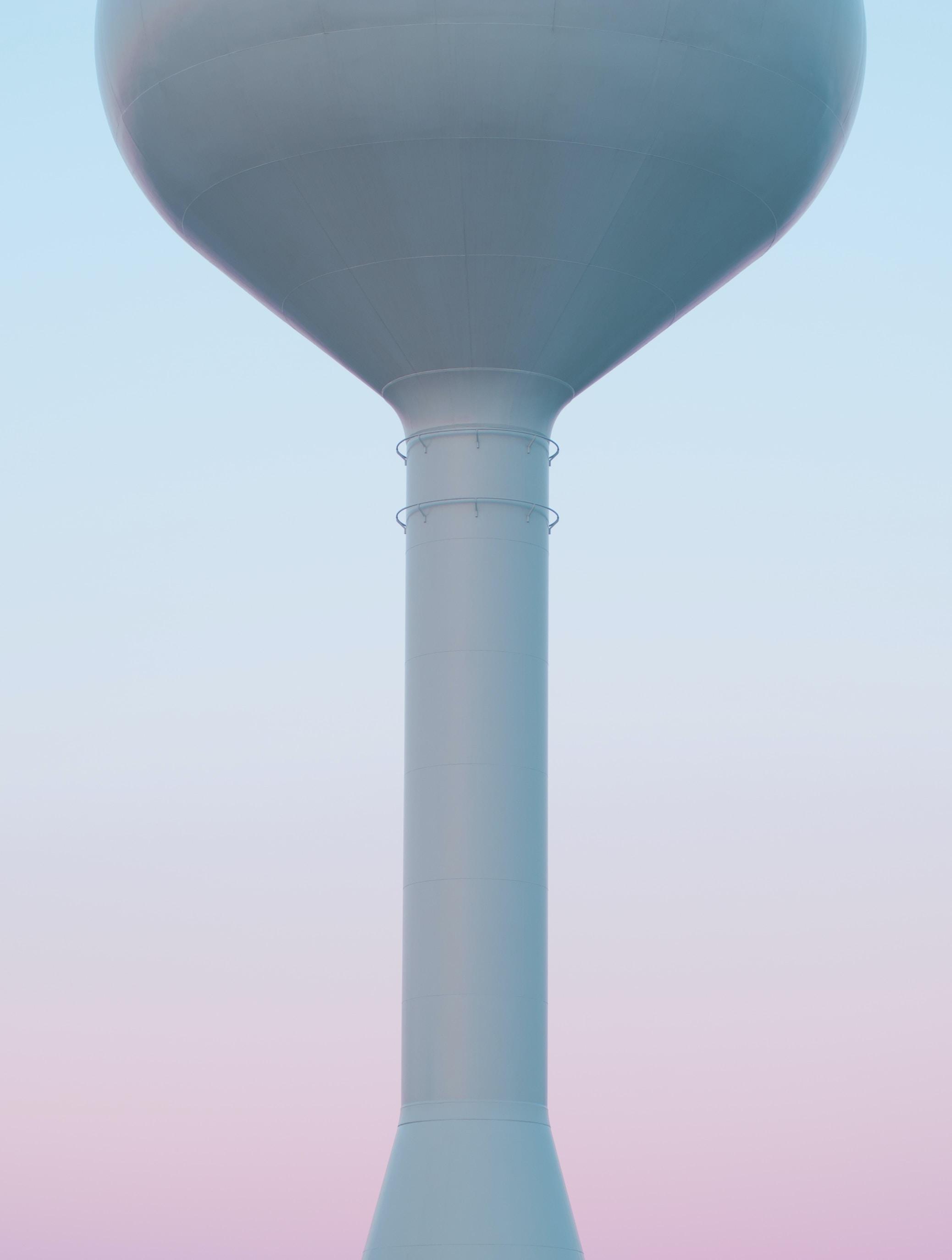 gray concrete silo under cloudy sky
