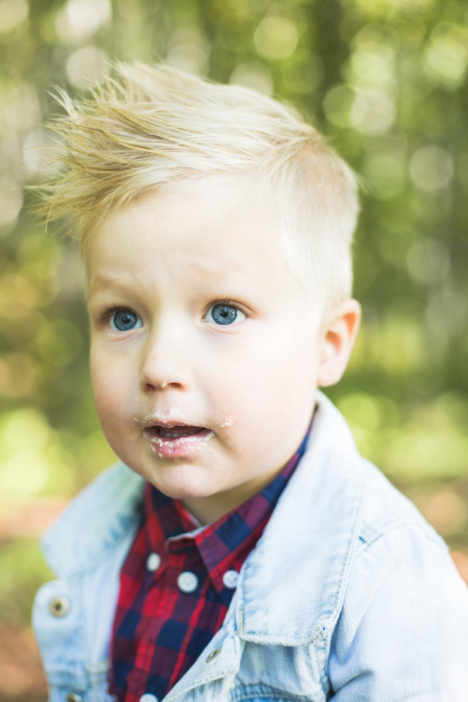 selective focus photography of boy