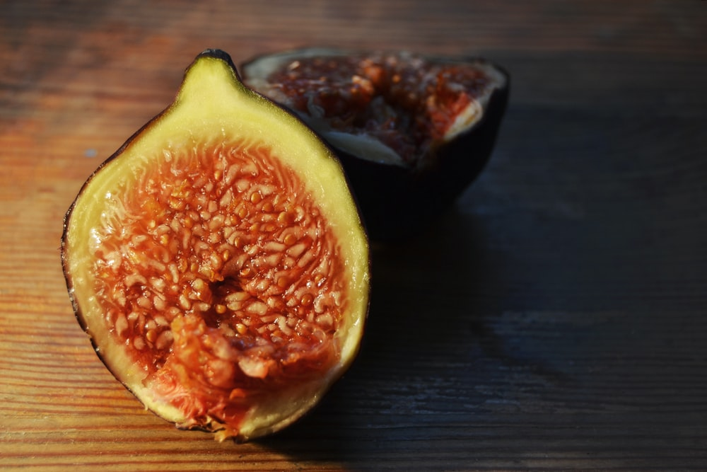 fig on brown wooden surface