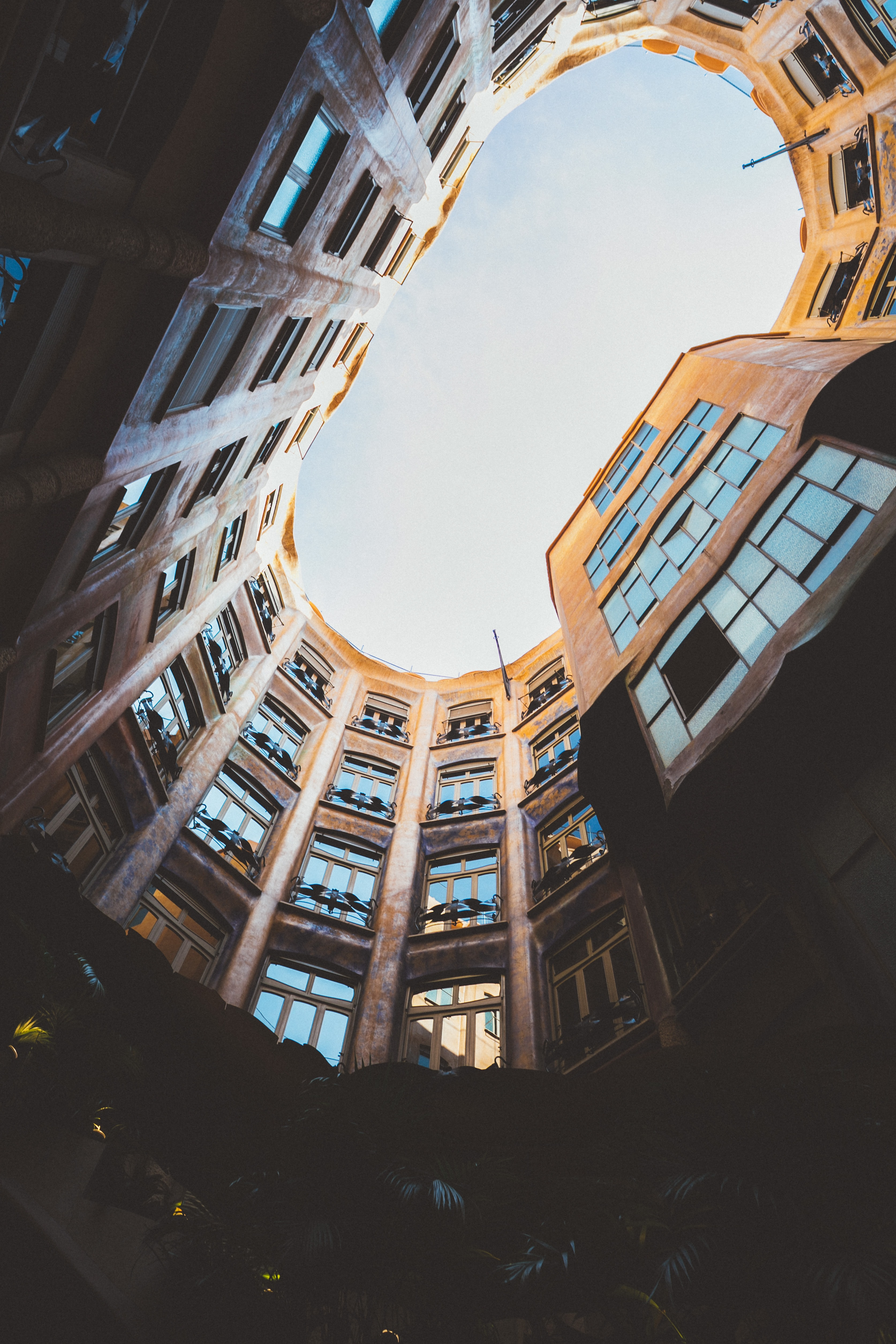 worm's eyeview photo of oval high-rise building ceiling