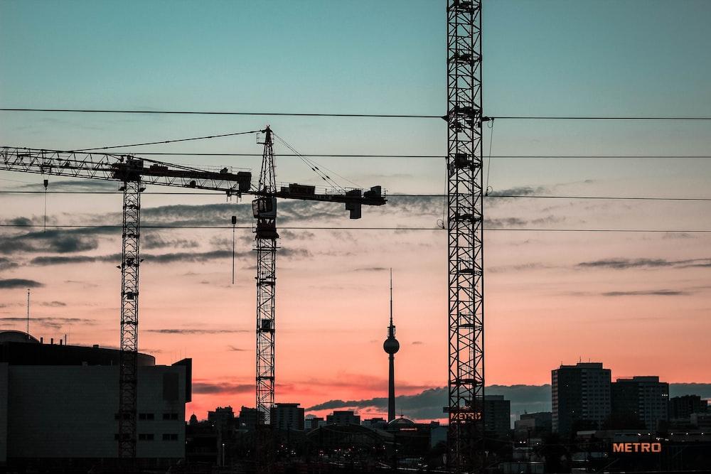 silhouette of crane trucks