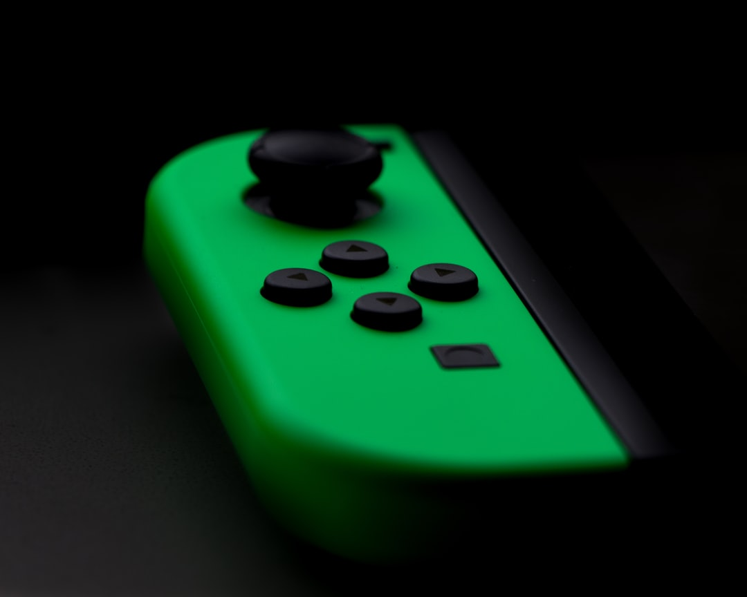Green Nintendo switch game controller, I love photography and just getting into it. I was playing with some light in my room with my window and came up with this picture.
