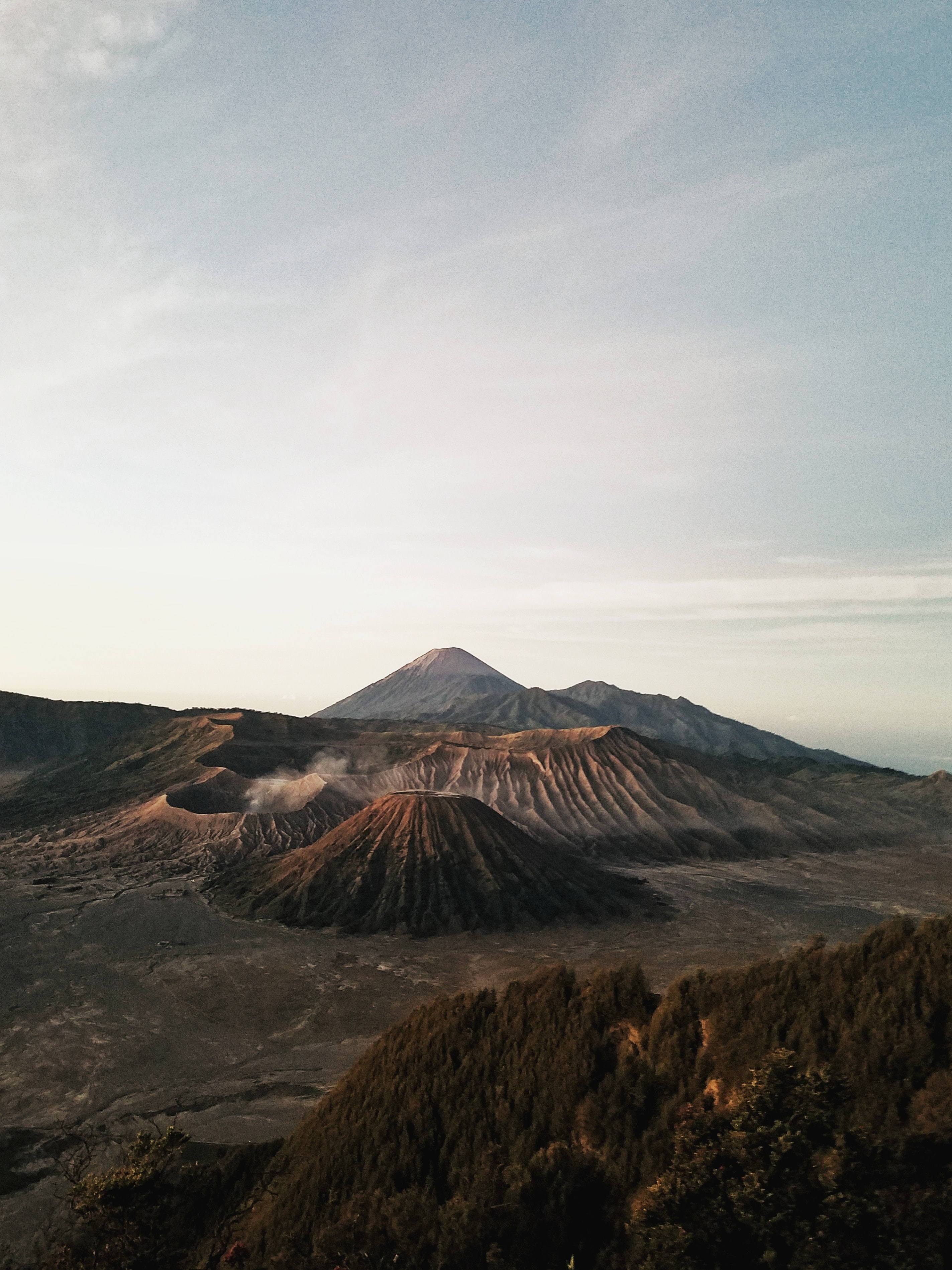 photo of crater and mountain