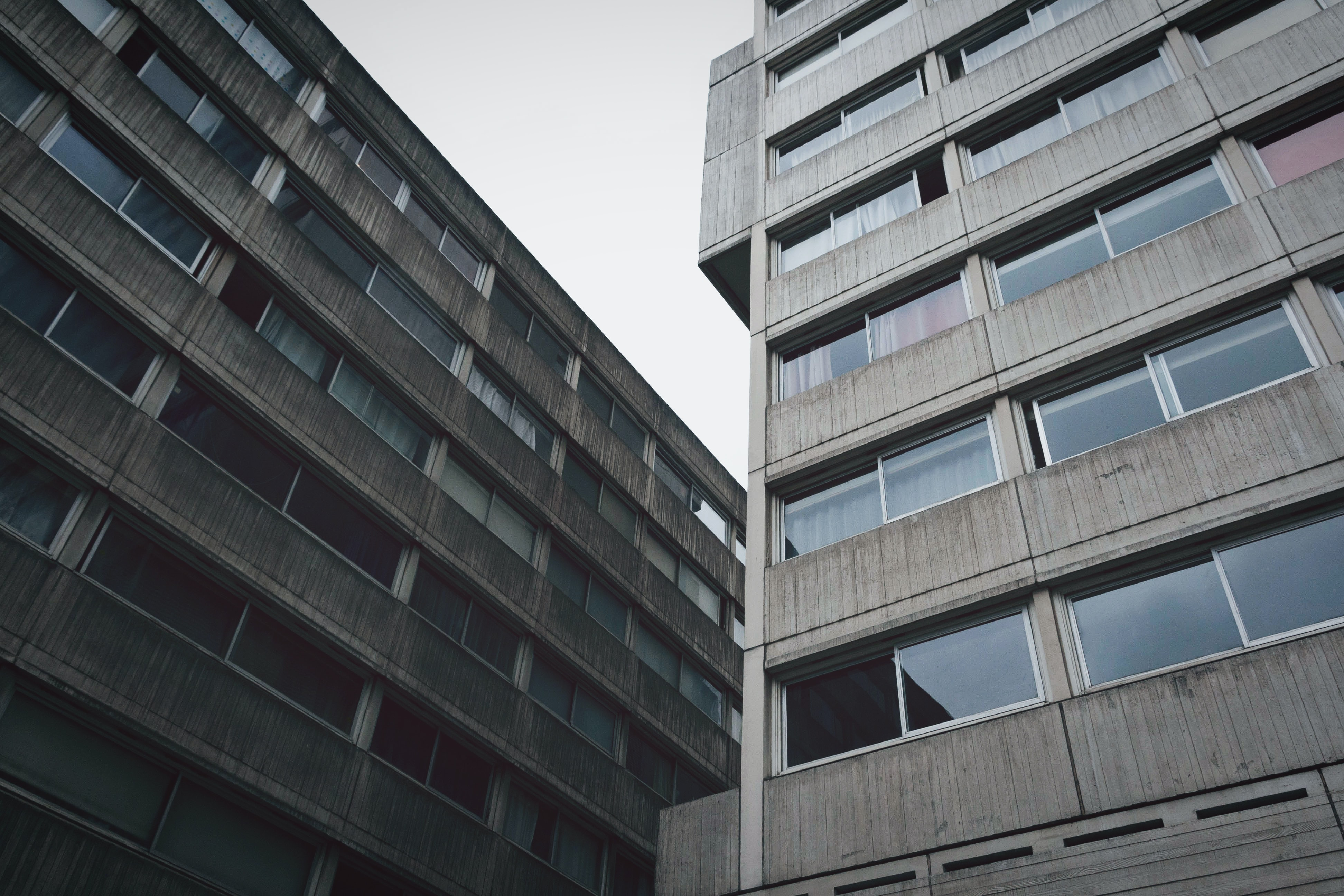 low-angle photo of two gray high-rise buildings
