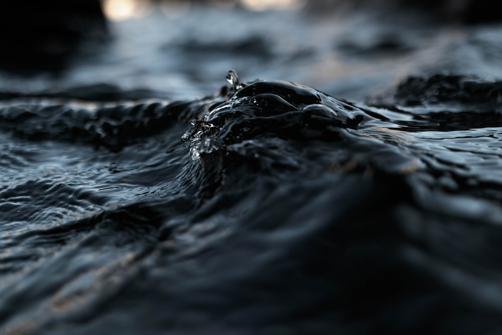 close up photo of black water at daytime