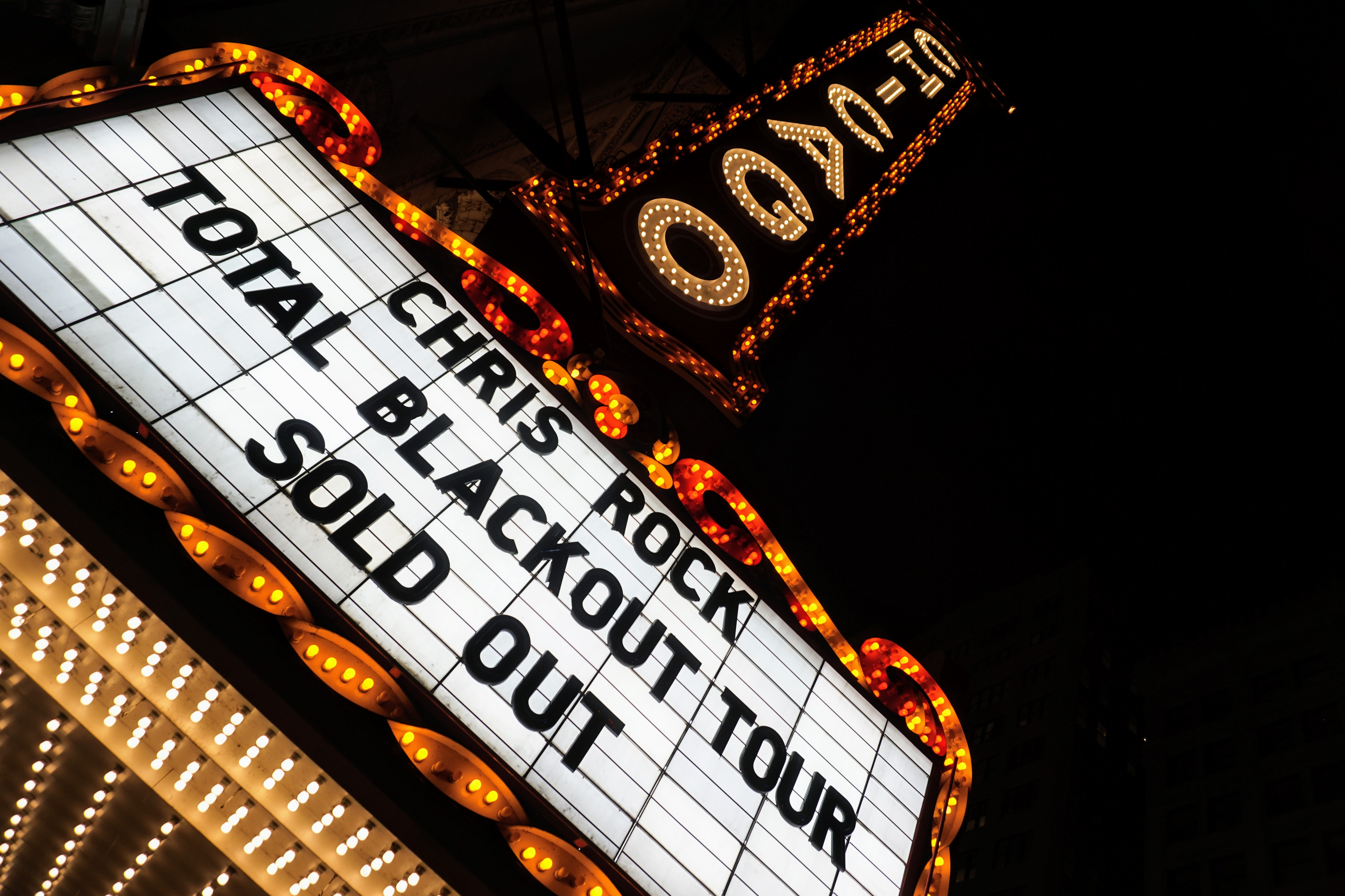 Chris Rock total blackout tour sold out neon signage