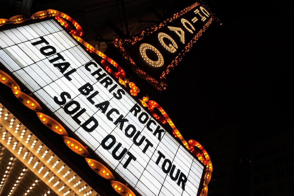 Chris Rock total blackout tour sold out neon signage