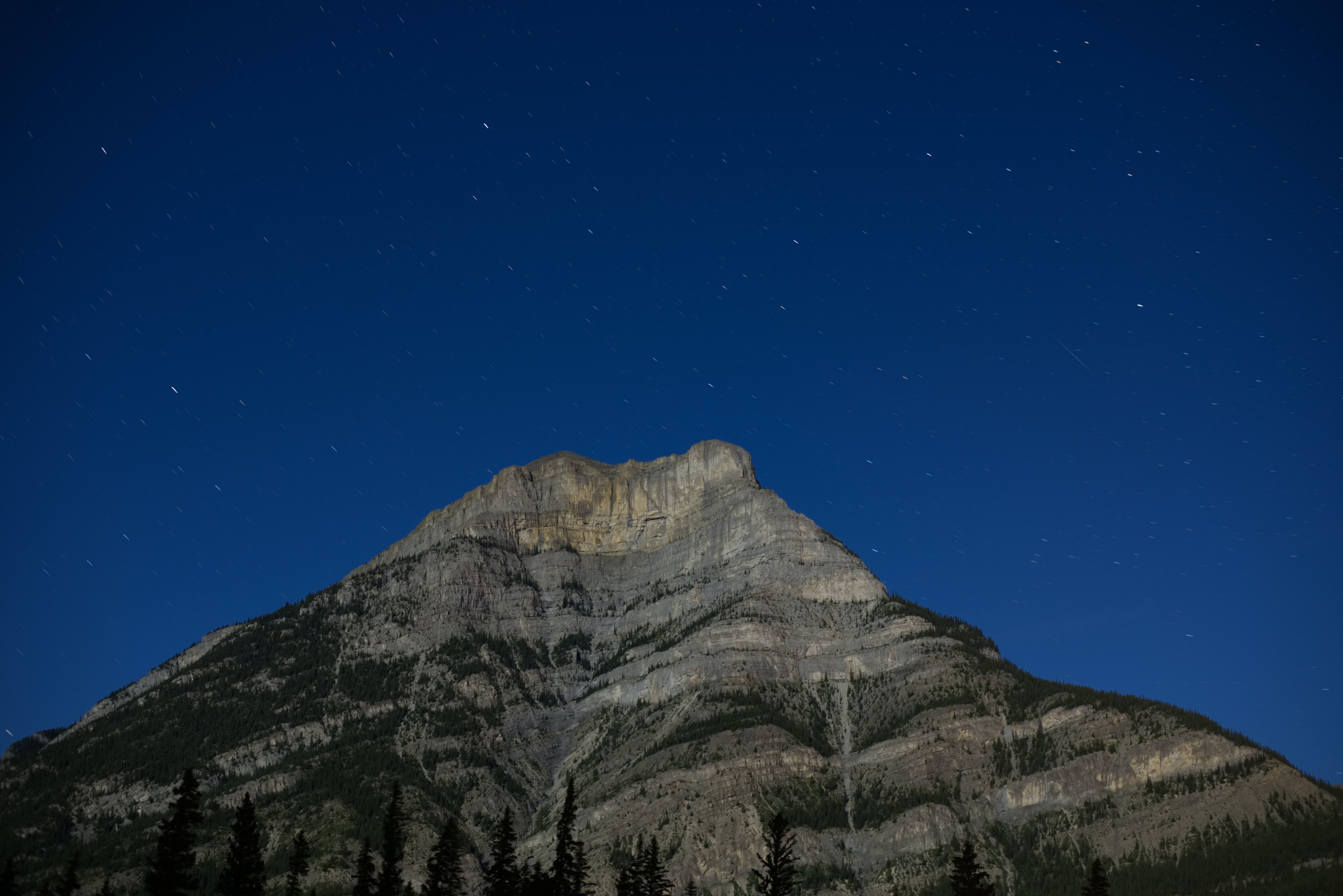 worm's-eye view photography of mountain under blue sky