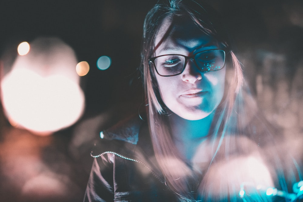 woman smiling during nighttime
