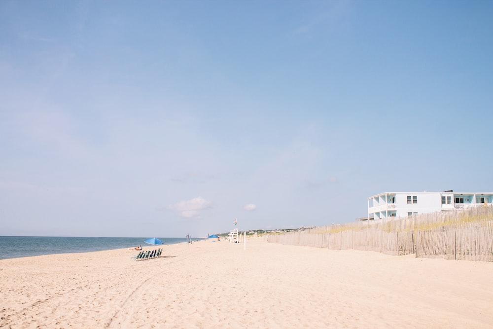 seashore under blue sky during daytime