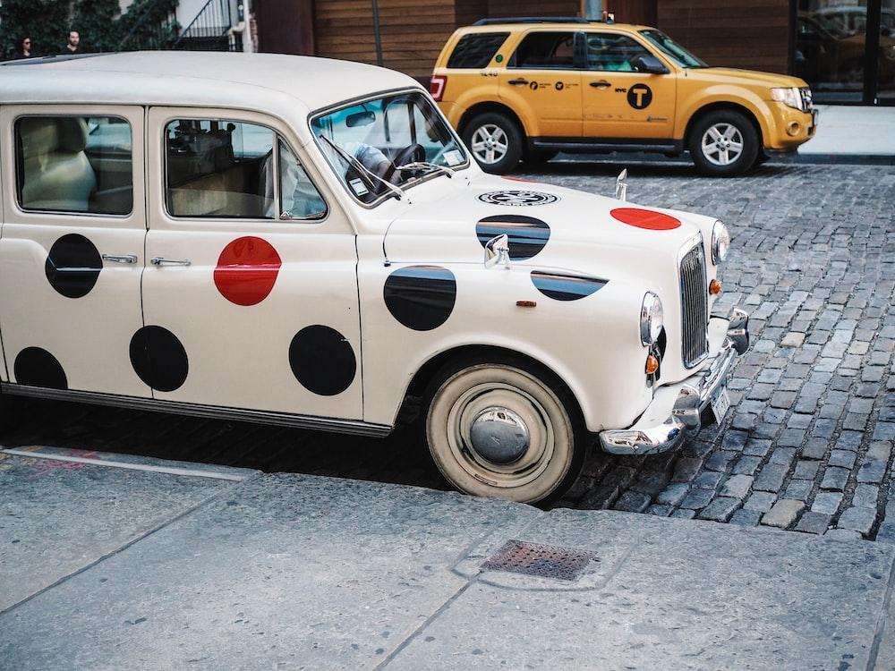 white polka-doted vehicle parked during daytime