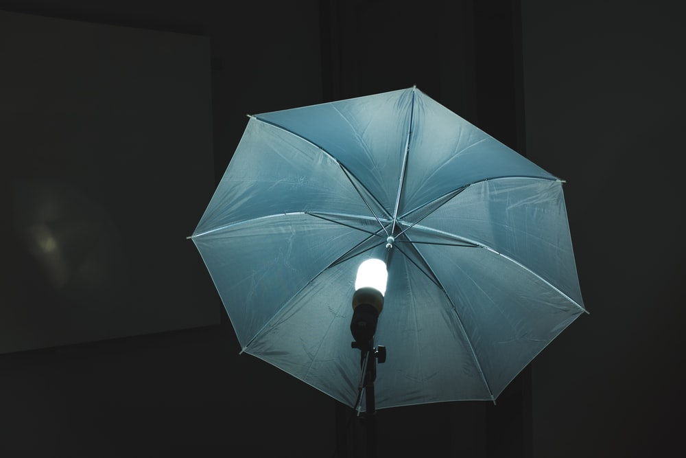 umbrella in front of switched on light