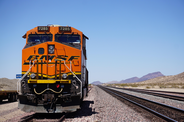 orange BNSF train at the rail
