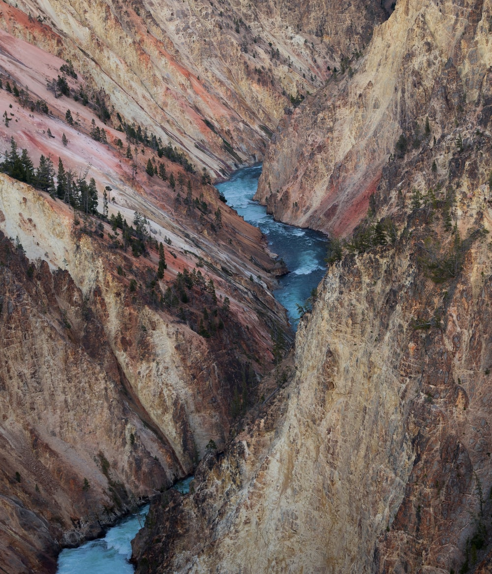high-angle photography of river in between mountain