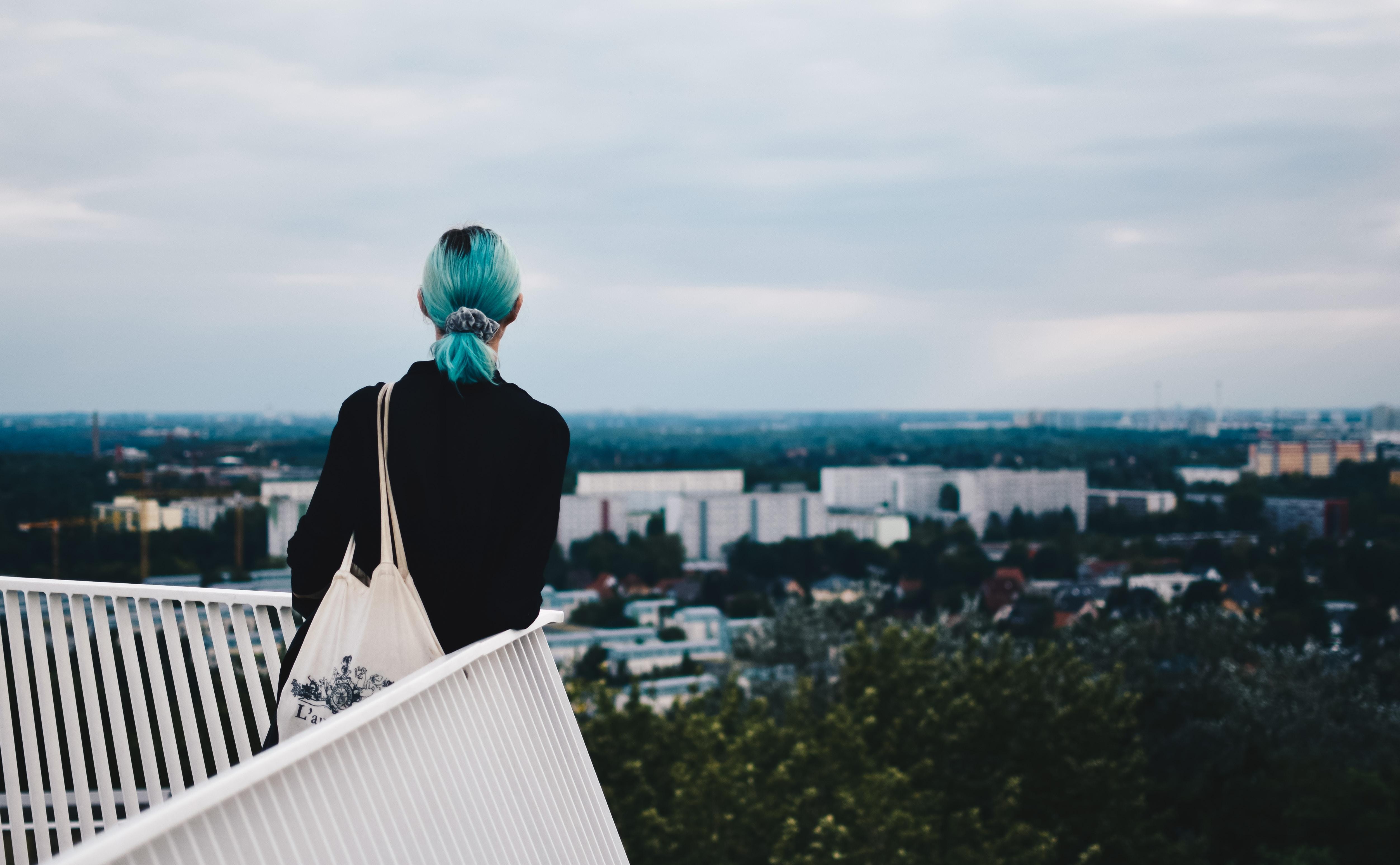 woman standing beside handrails
