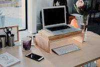 silver MacBook on desk