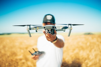 shallow focus photography of quadcopter drone teams background