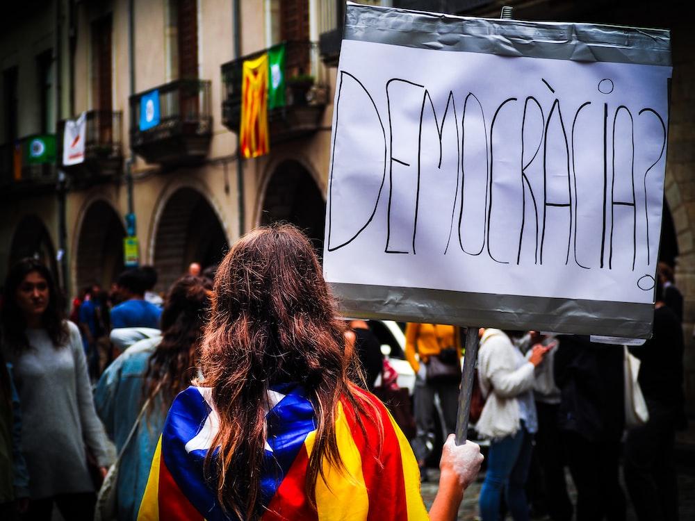 woman holding democracia signage