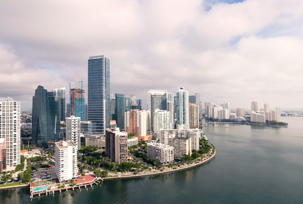 aerial photography of high-rise buildings near sea