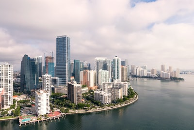 aerial photography of high-rise buildings near sea miami teams background