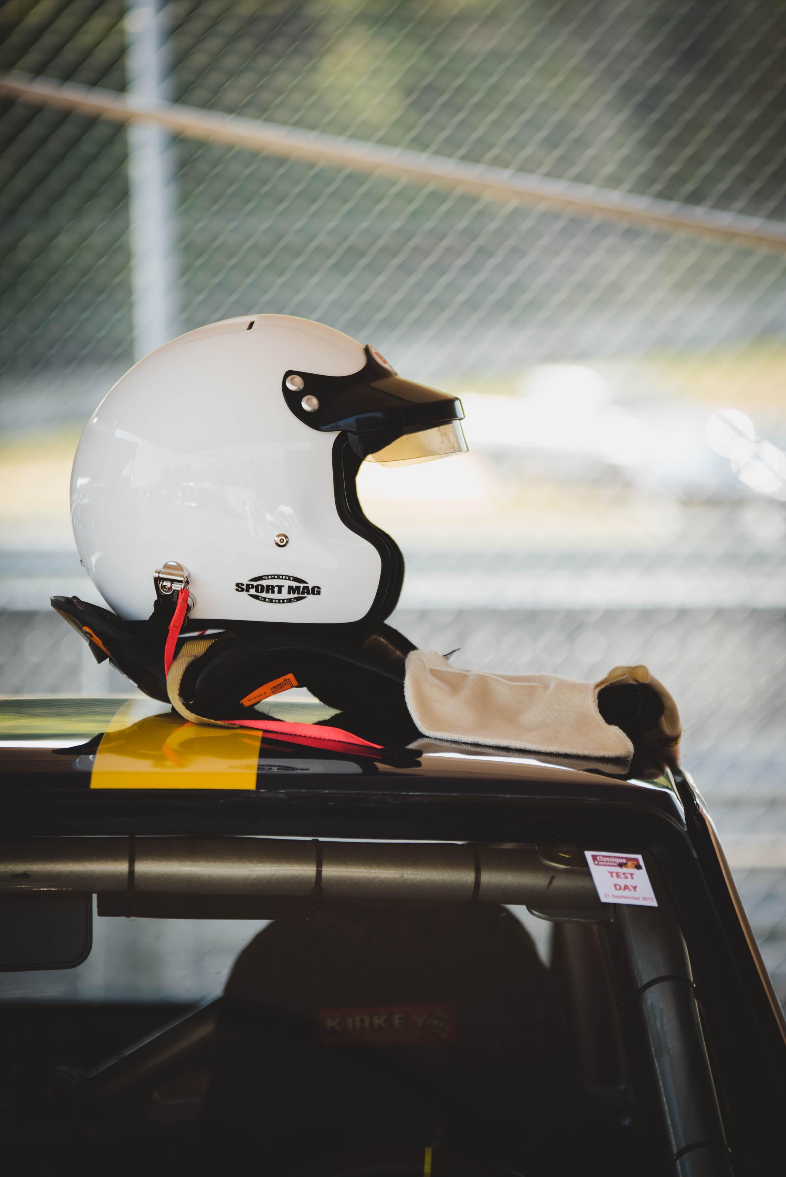 white half-face helmet on vehicle rooftop