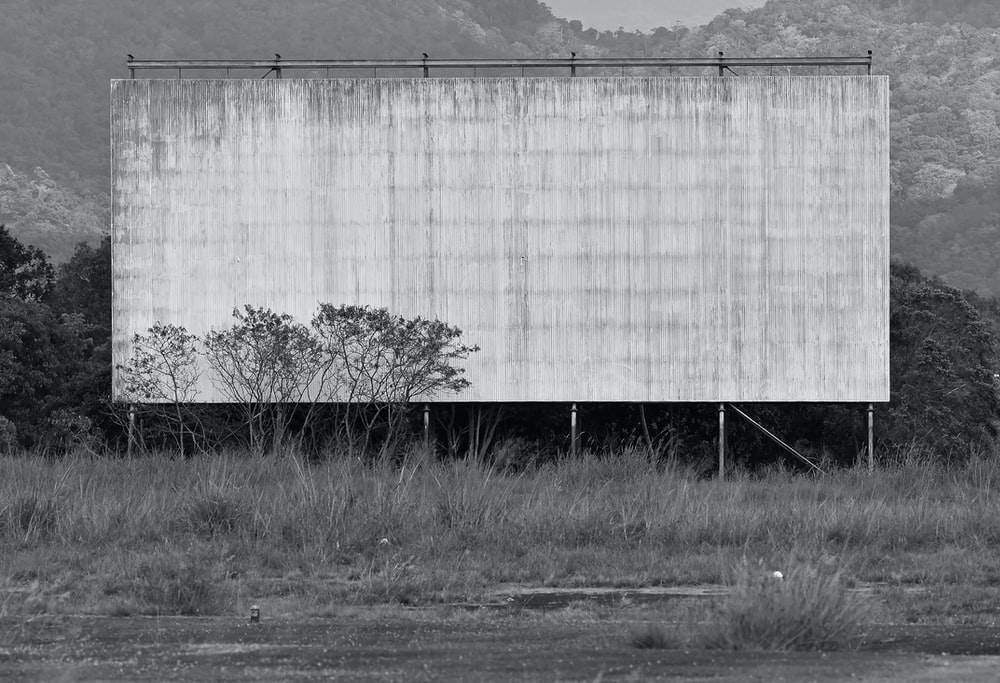 grayscale photography of billboard