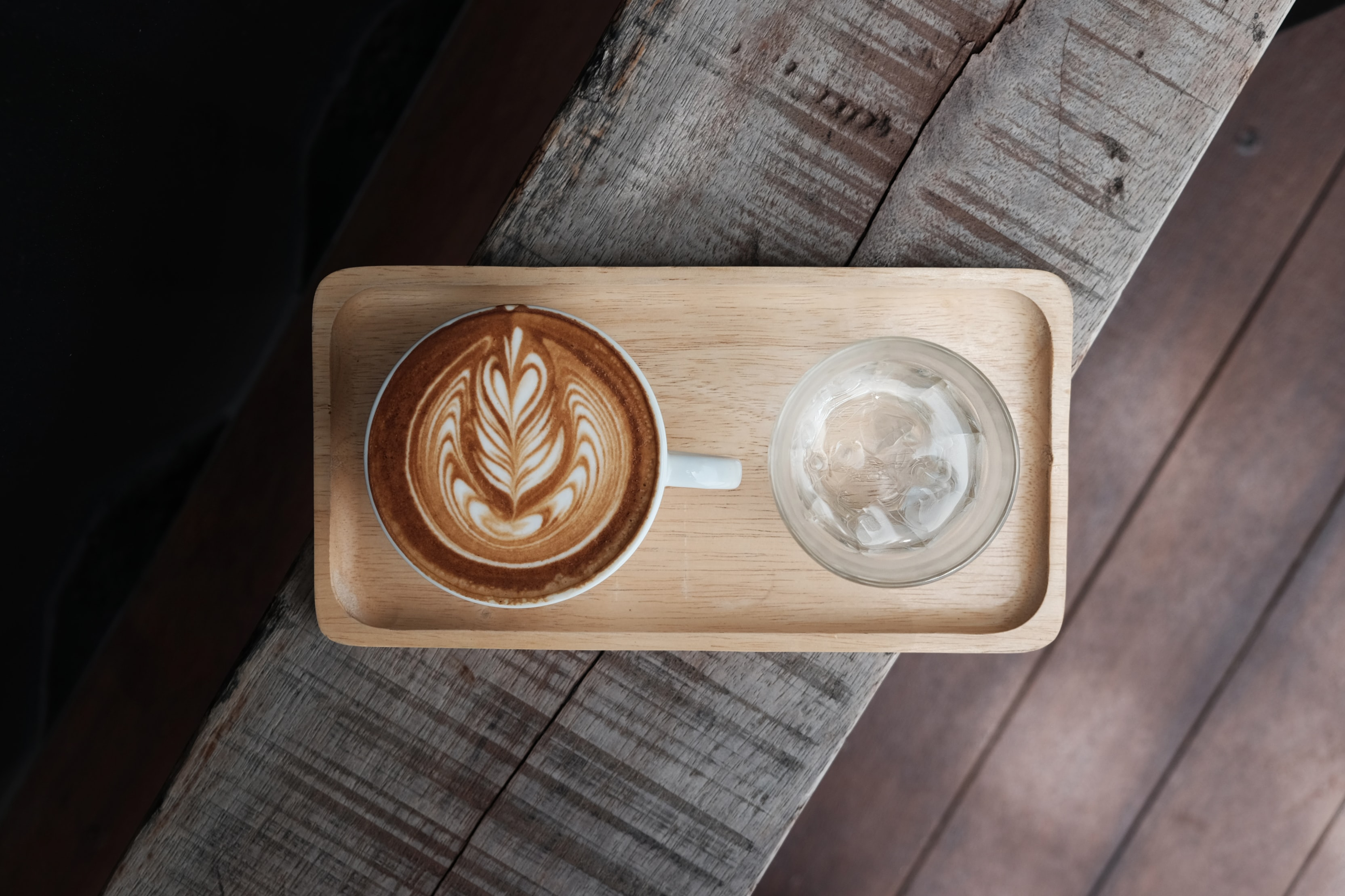 photo of coffee latte on tray