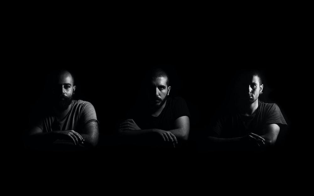 greyscale photo of three men