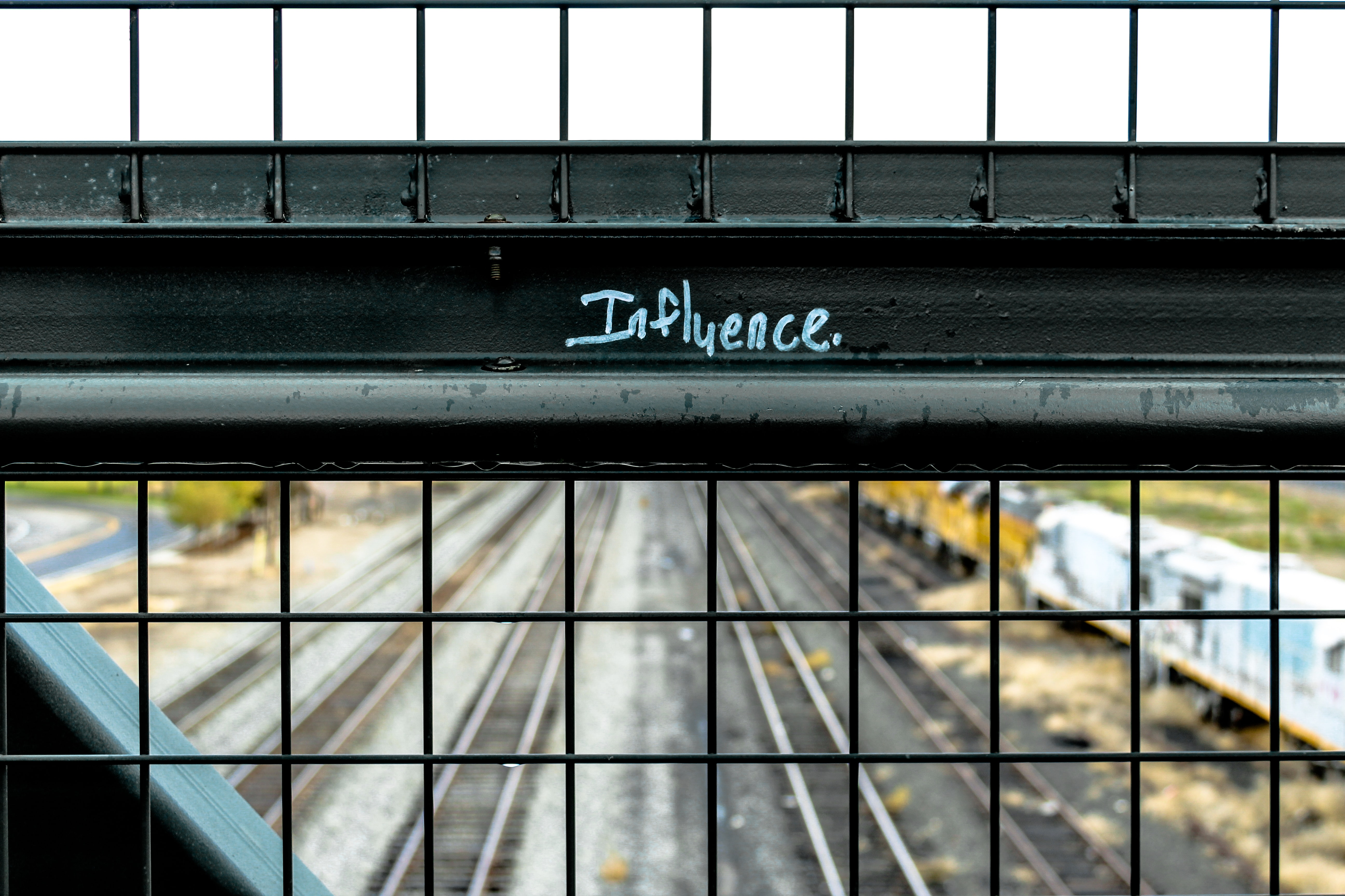 influence painted black metal frame during daytime
