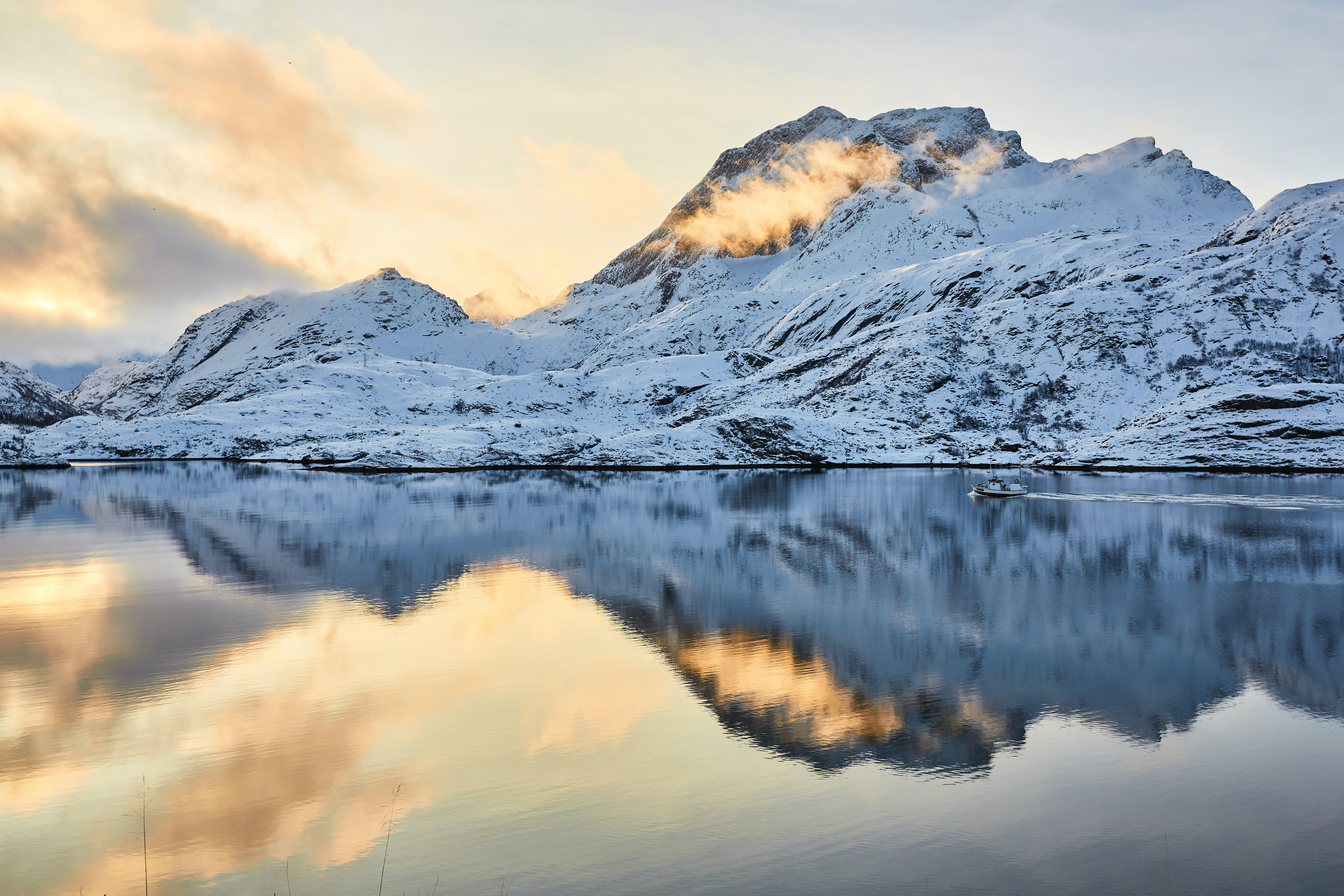 mountain with snow and reflection on water