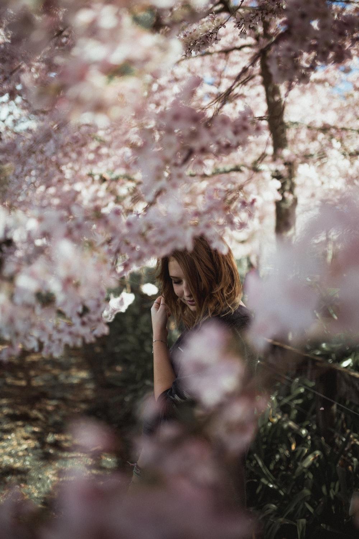 woman near cherry blossom tree