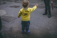 boy wearing yellow hoodie