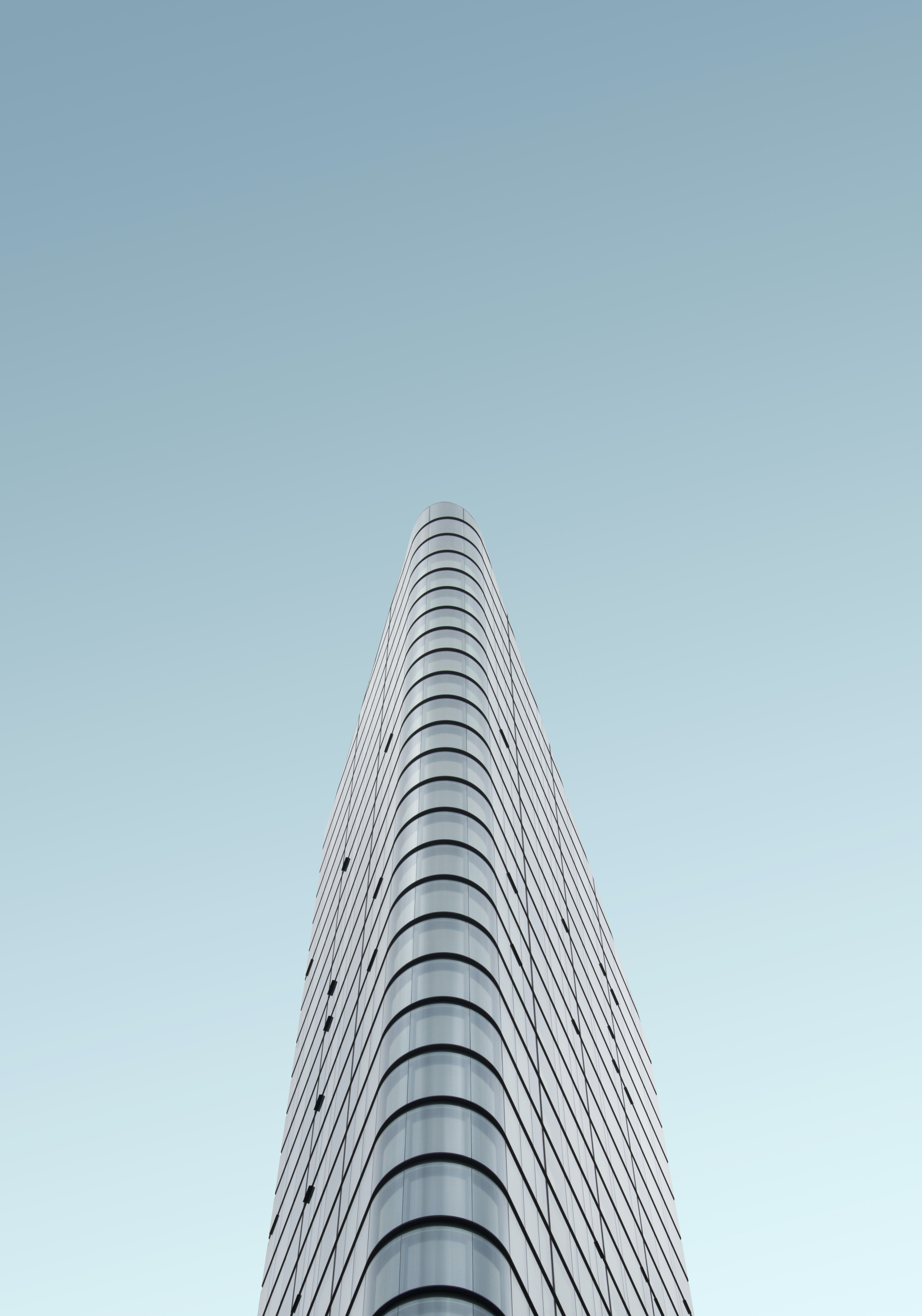 grey glass high-rise building during daytime