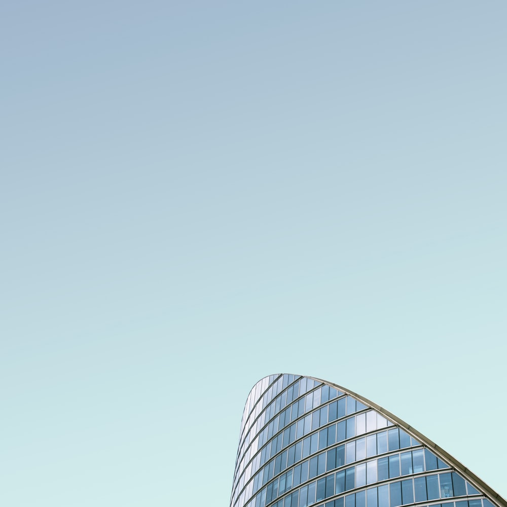 curtain wall building under blue sky