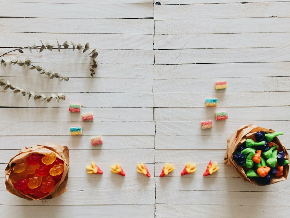 selective focus photography of candies on surface