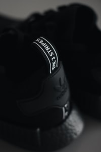 selective focus photography of Adidas NMD shoe