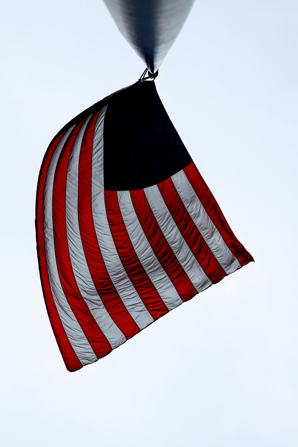 United State of America Flag on black metal post during daytime