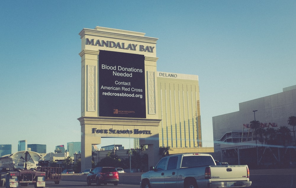 cars passing by Mandalay Bay during daytime