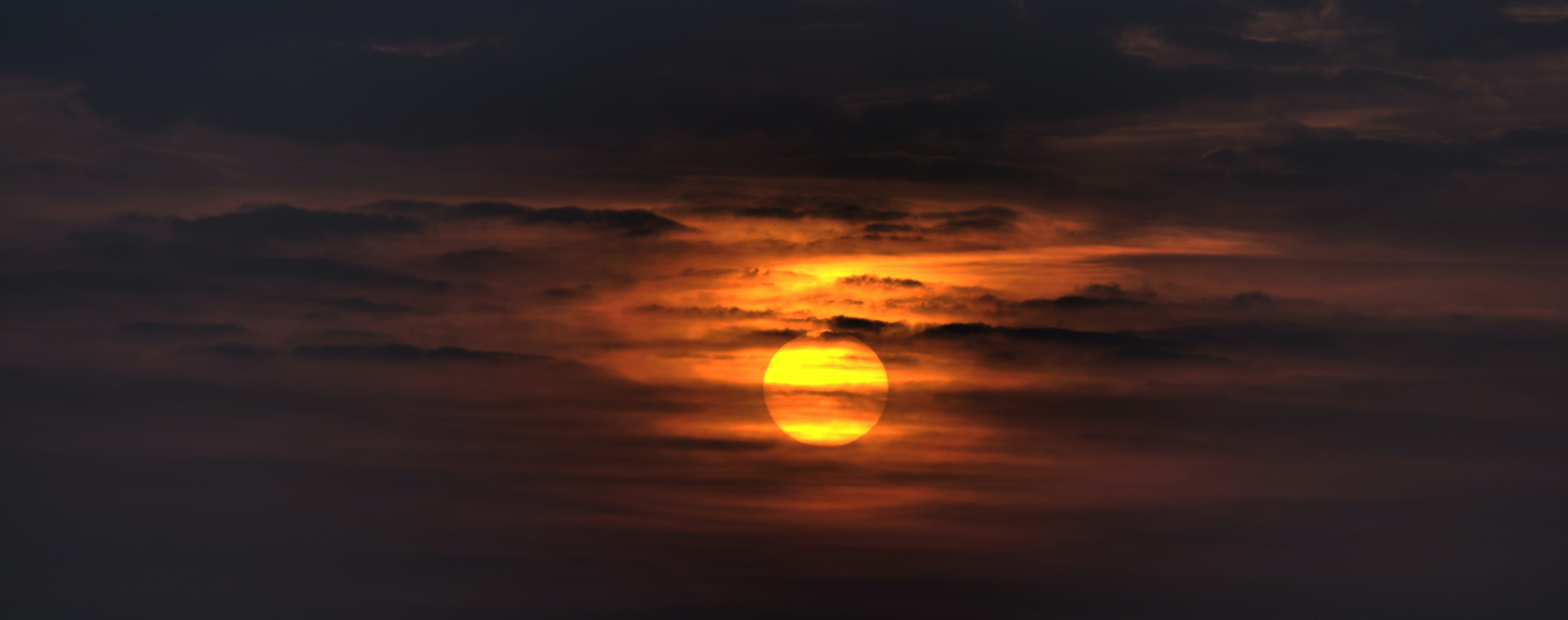 sunset covered by cloudy skies