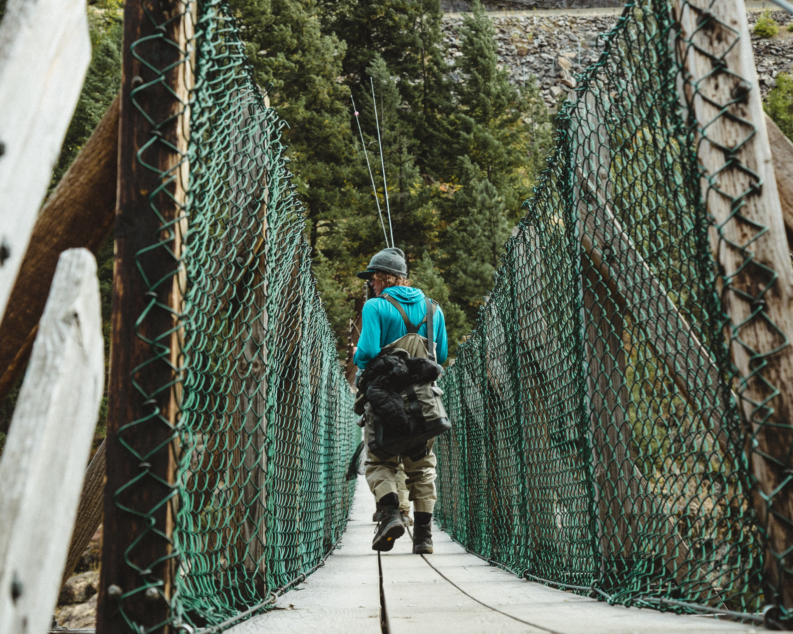 man on green hanging bridge