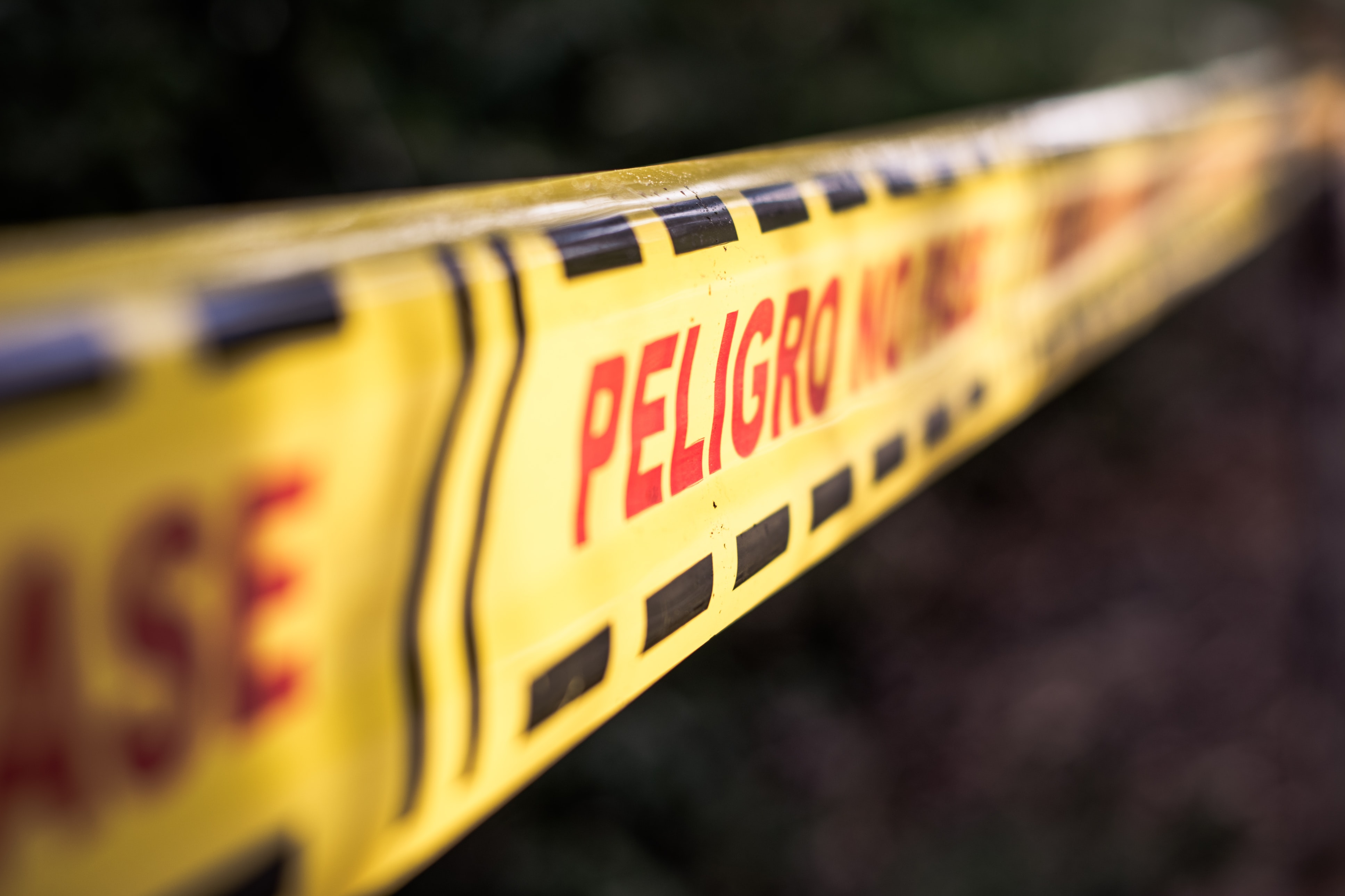 closeup photography of Peligro signage