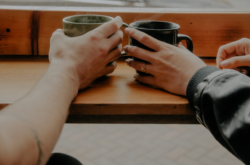 person holding mugs photo
