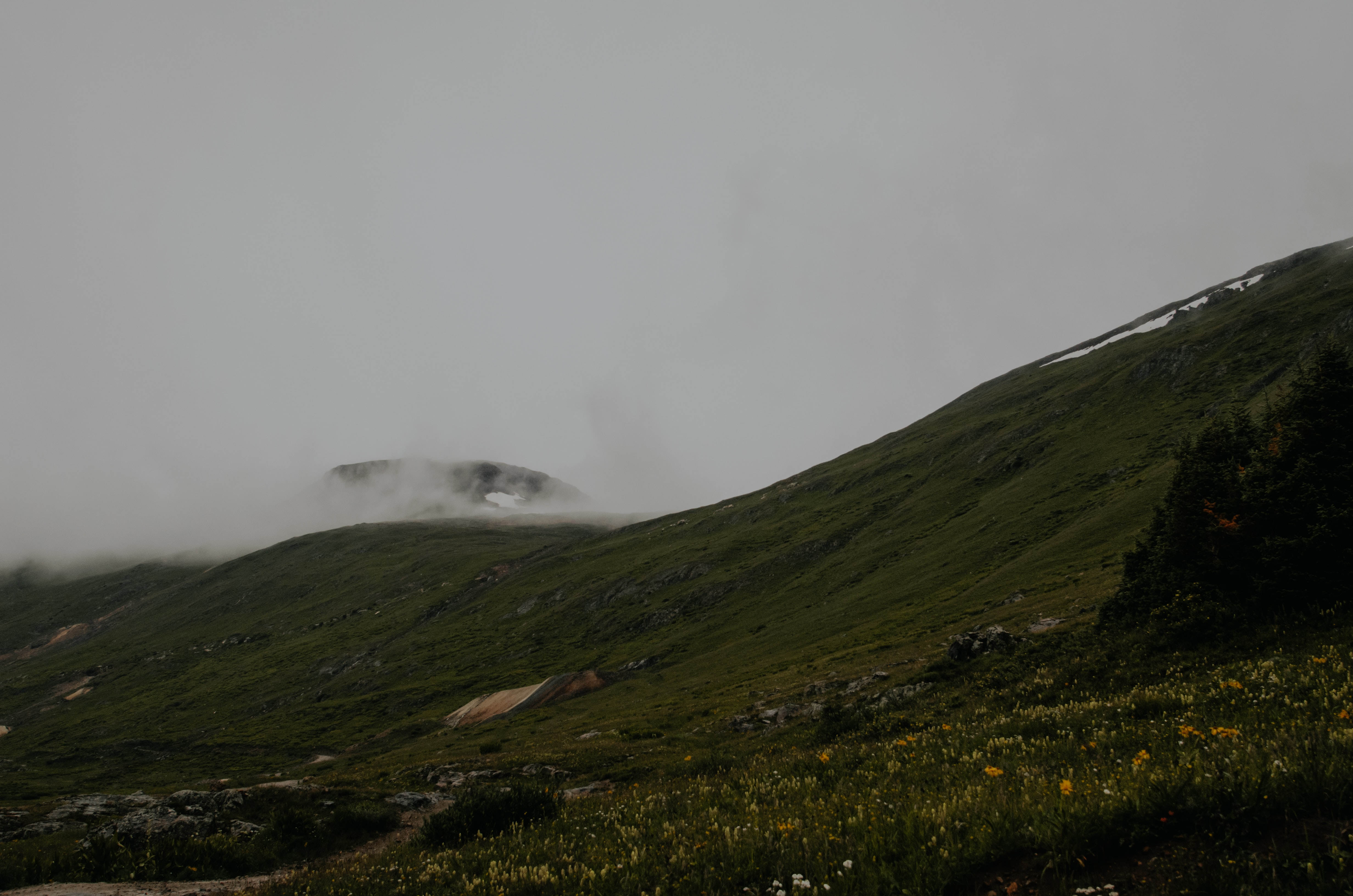 green mountains under gray sky during daytime
