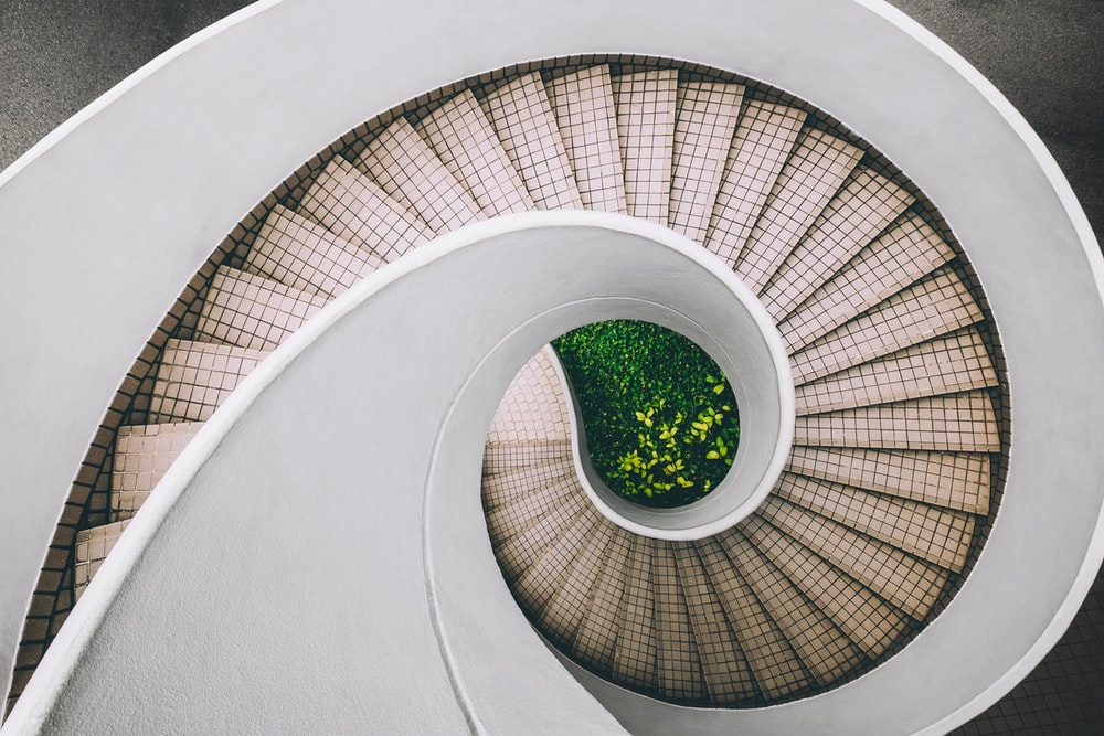 white and brown concrete spiral stairs