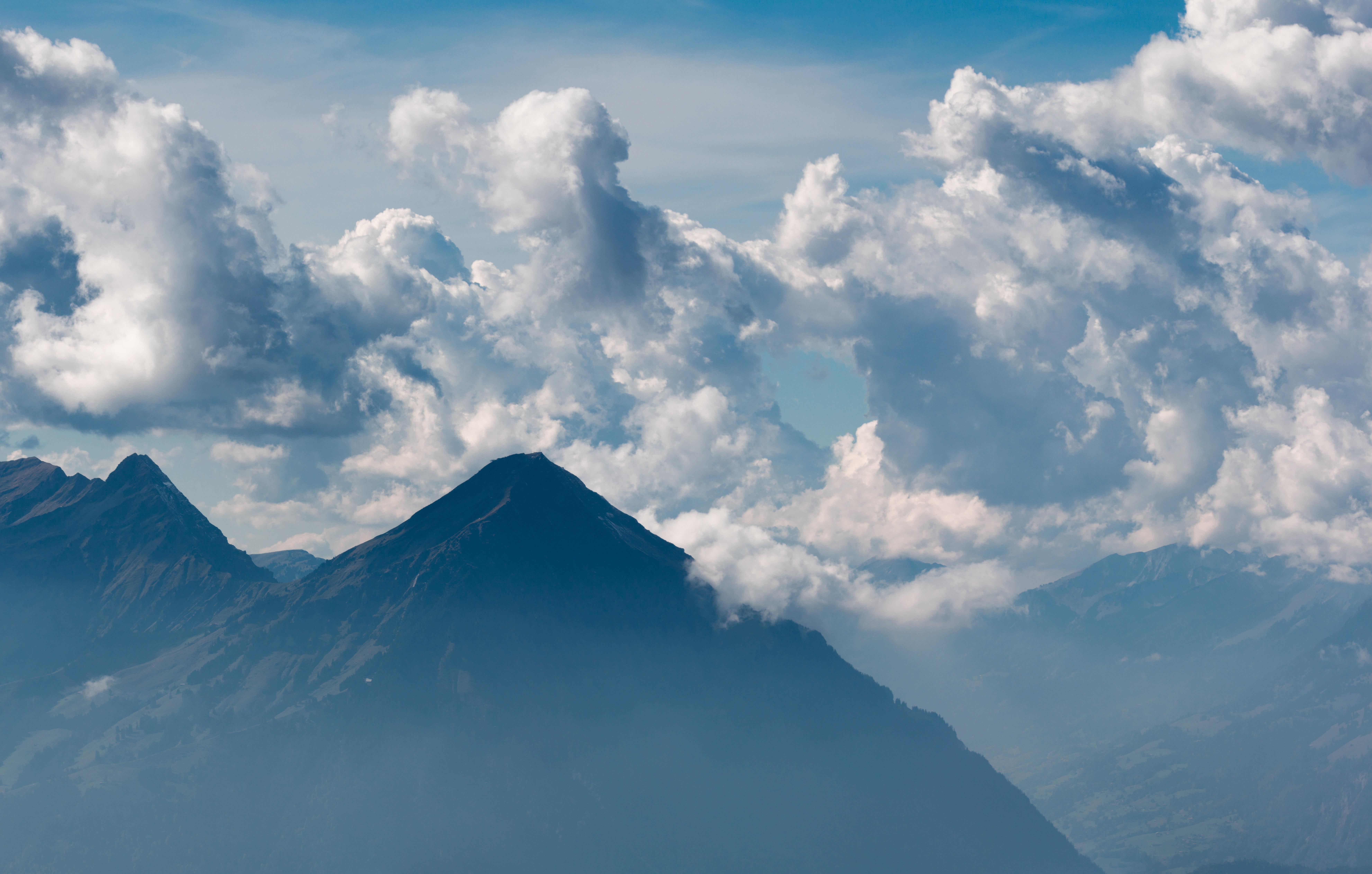 mountain landscape with clouds during daytime