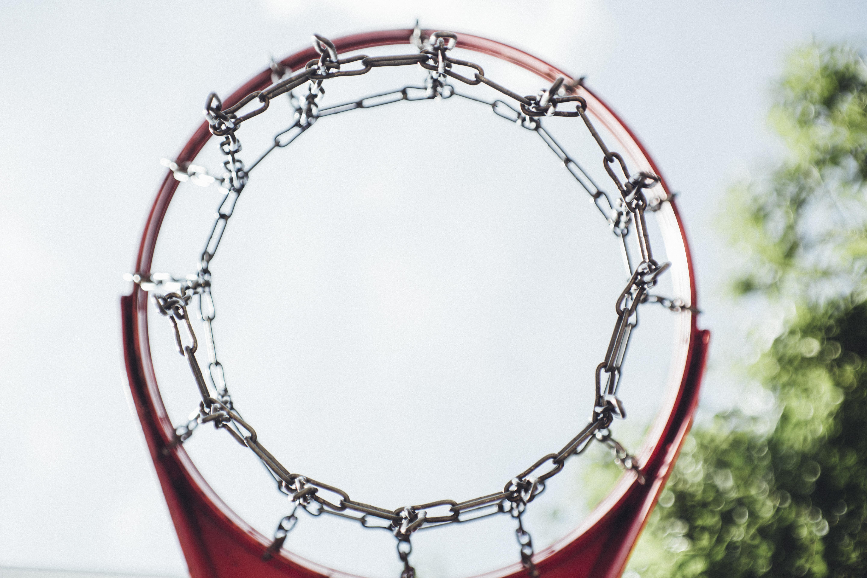 gray and red metal basketball hoop